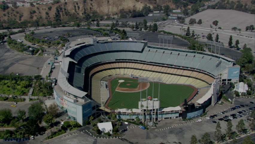 Los Angeles - Circa 2009: Dodger Stadium in 2009. Circling over Dodger Stadium then zooming back the view to see the City of Los Angeles, California.