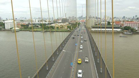 Aerial view on traffic on the cable-stayed bridge Rama VIII through the Chao Phraya River, Bangkok, Thailand