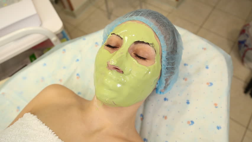 Woman with green mask on her face   Shutterstock HD Video #23271364
