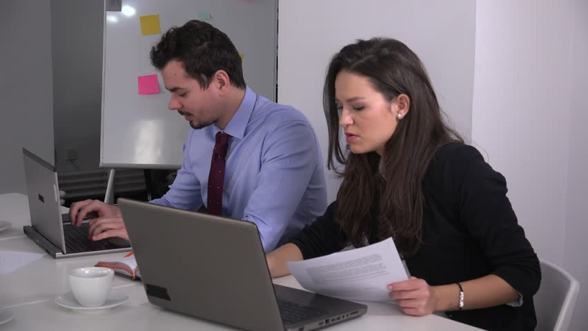 Business couple in the office working hard on laptop young businessman activity | Shutterstock HD Video #23272558