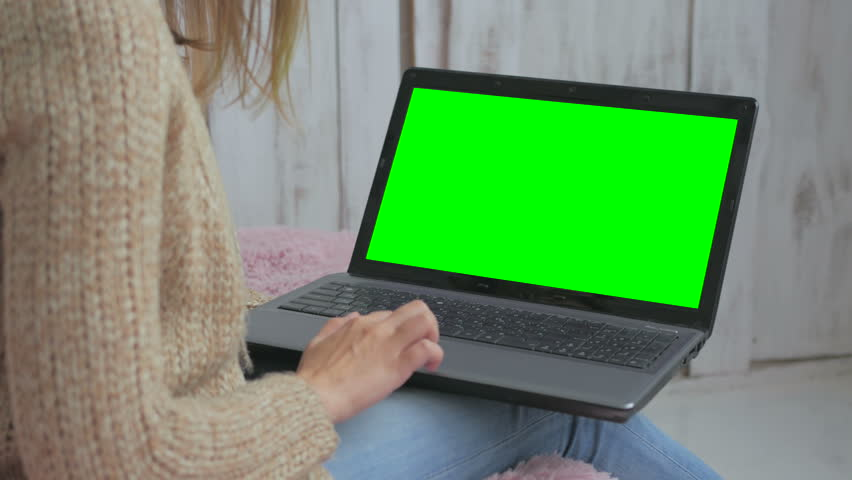 Woman using laptop with green screen. Business, communication, freelance and internet concept | Shutterstock HD Video #23275306