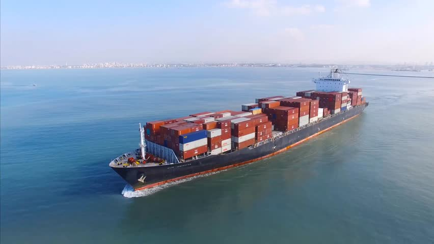 Circa, Circa, January 18, 2017: Aerial footage a large container ship leaving a commercial port, heading for it's next destination port. | Shutterstock HD Video #23280994