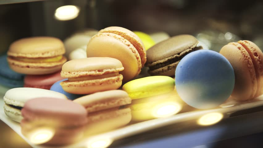 Colorful macaroons on showcase in a fancy cafe. Closeup real time locked down shot.  | Shutterstock HD Video #23290987