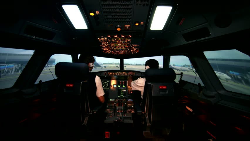 Preparing for departure and take off. Aero plane on runway of modern airport. Cabin crew perform pre-flight procedure, all lights and lamps are on