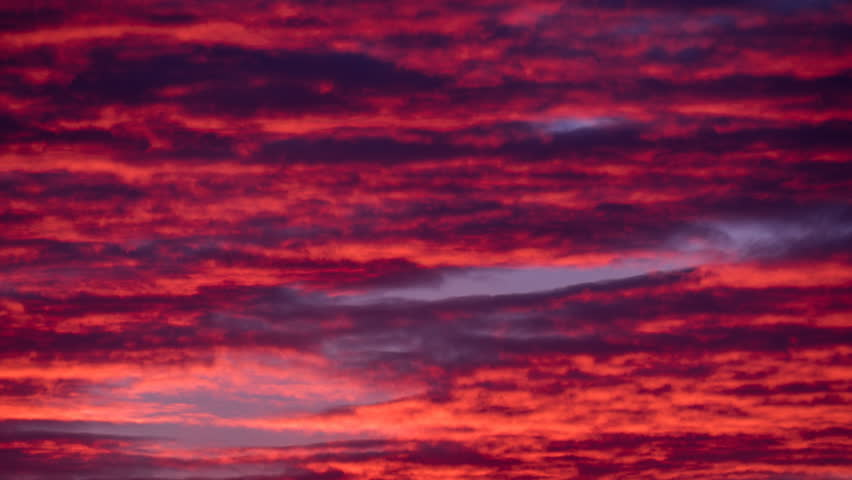Red purple violet pastel sky timelapse. Cirrus stratus cumulus cloud scape. Aero ozone airy wispy cloud fast motion time lapse. Day night sunset sky clouds movement. Fantastinc majestic dramatic sky