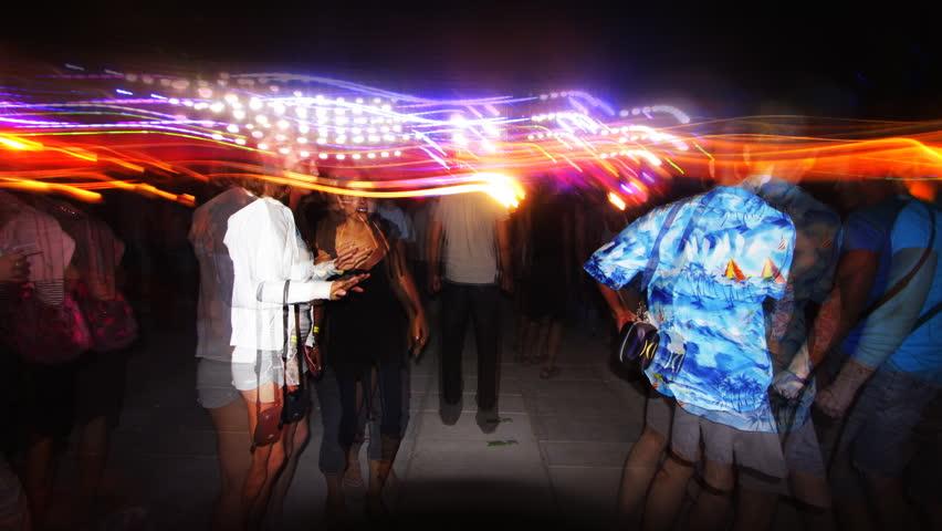 POPOVKA, UKRAINE - JULY 20: Image sequence using long exposure shooting technique to capture people dancing on dancefloor at Kazantip electronic dance music festival on July 20, 2009 in Popovka, Ukraine.