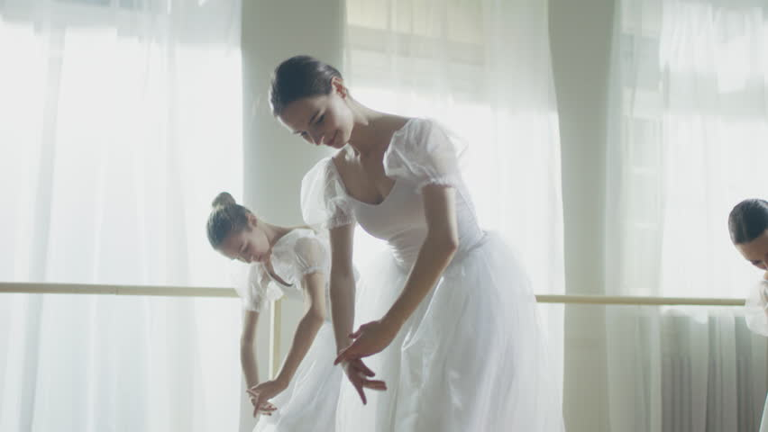 Three Young and Gorgeous Ballerinas Synchronously Dancing. They Wear White Tutu Dresses. Shot on a Sunny Morning.In Slow Motion.Shot on RED EPIC-W 8K Helium Cinema Camera. #23337361