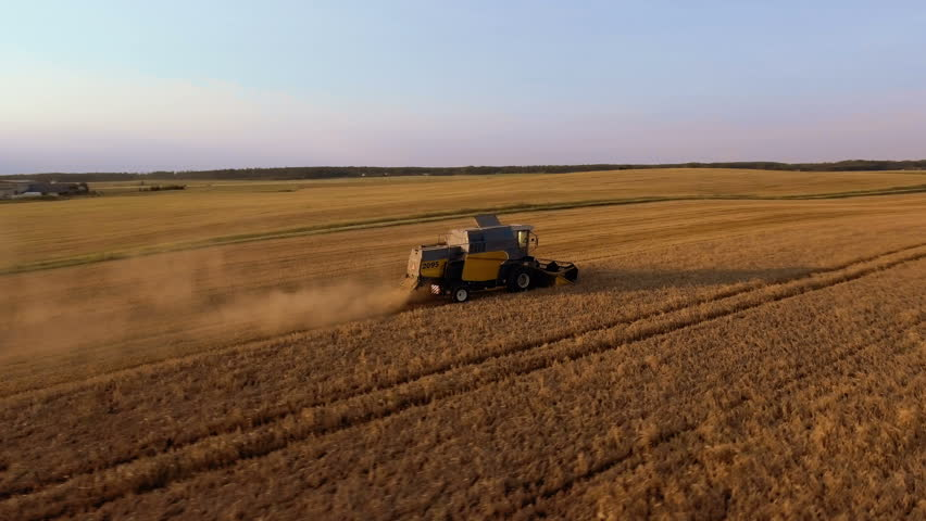 Flying Around Working Agricultural Harvester on Wheat Field at Sunset Time. | Shutterstock HD Video #23337874