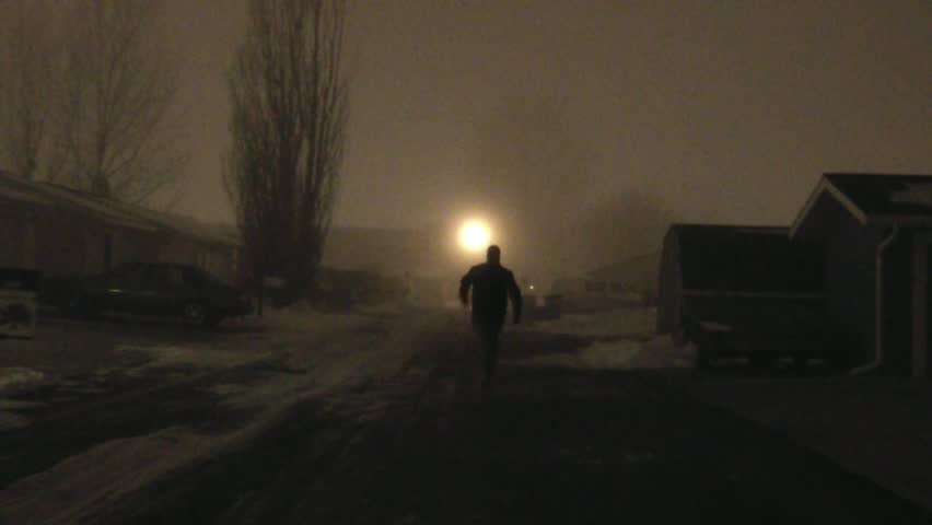 Masked Man Running Away in Alley at Night