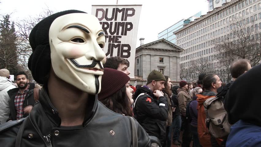 PORTLAND, OREGON - CIRCA 2017: Anonymous masked man attends an anti Donald Trump rally on inauguration day in Portland, Oregon.