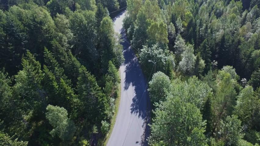 Drone shot of a biker driving up Grefsenkollen in Oslo, Norway, follow slow #23350735
