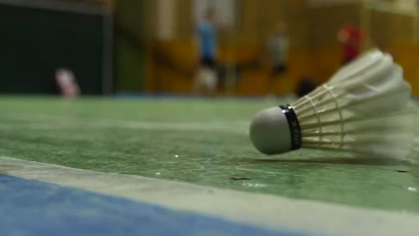 Slow motion shot of the shuttlecocks on the floor of badminton courts