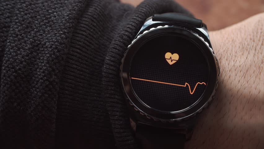 Lviv, Ukraine - January 2017: Smartwatch showing the heart rate to the user.