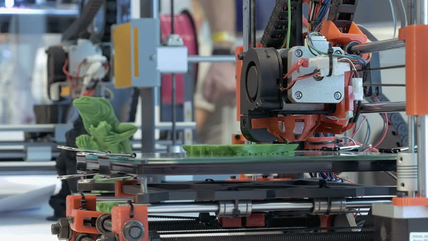 Kiev, Ukraine - October 25, 2016: Automatic three dimensional 3d printer performs product creation. Modern 3D printing or additive manufacturing and robotic automation technology.   Shutterstock HD Video #23395885