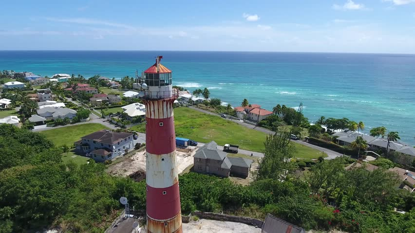 Amazing Aerial orbit view around an old rustic and Historic lighthouse building in Barbados, Caribbean