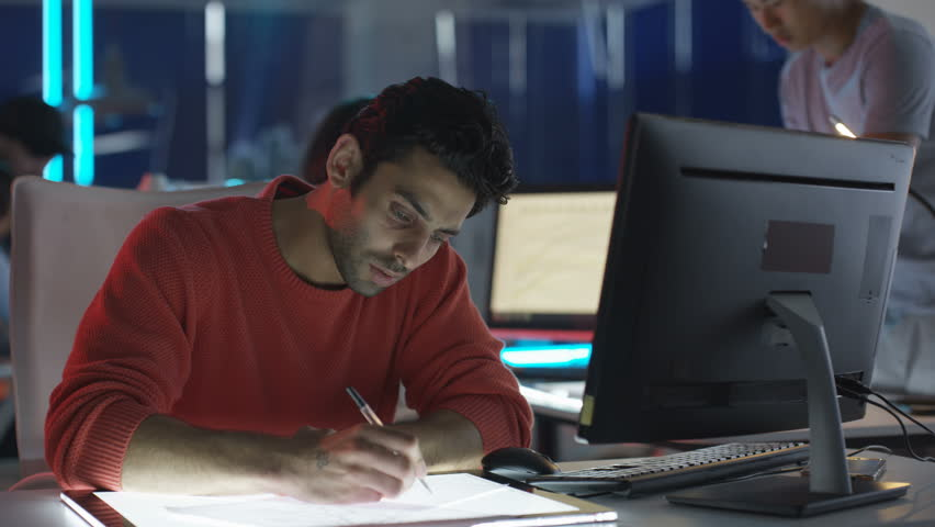 4K Young creative computer game designer working with colleagues in dark office   Shutterstock HD Video #23440681