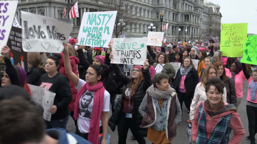 """WASHINGTON, DC - JAN. 21, 2017: Women's March on Washington on 17th St. near White House; """"Donald Trump Has Got to Go"""" chant, part of gigantic turnout that flooded DC in show of solidarity."""