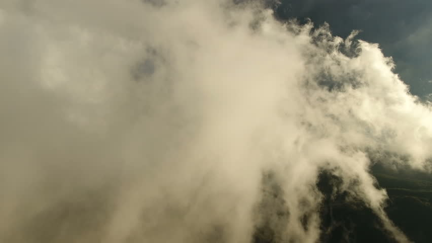 Fly through the clouds. Aerial drone smooth filming above puffy clouds. | Shutterstock HD Video #23460688