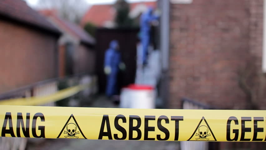 Asbestos Removal team behind yellow warning tape in Holland
