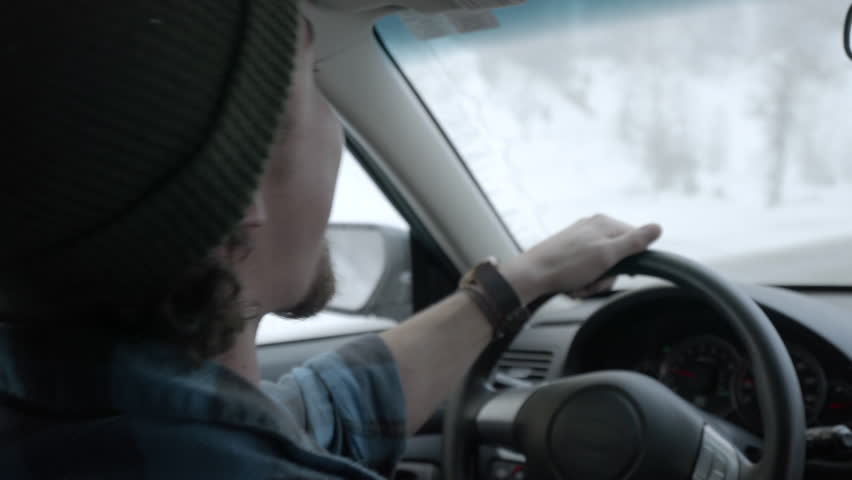 Happy Young Man Sings And Dances While He Drives Up Canyon Road In Snowy Mountains Of Utah | Shutterstock HD Video #23477872