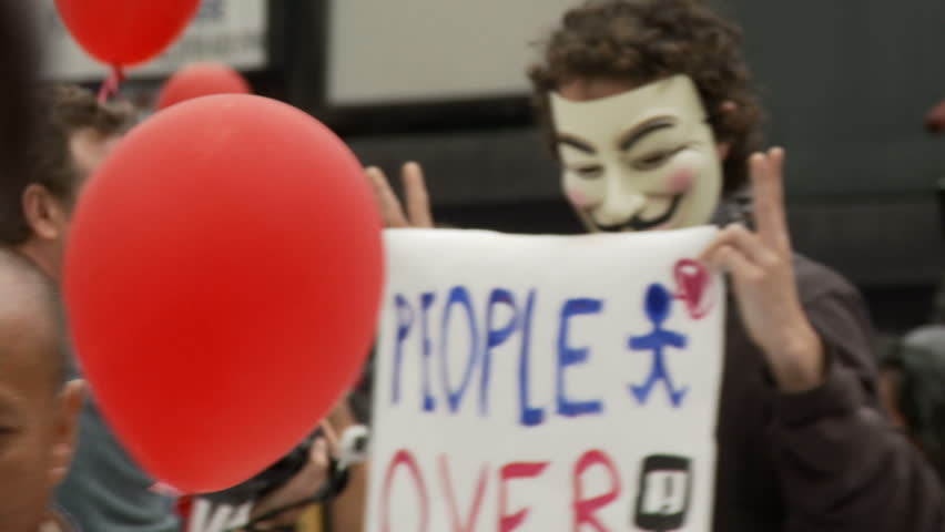 Anonymous in the Crowd. Protester wears a 'vendetta' mask at an Occupy Rally in downtown Los Angeles, California on May 1st, 2012.