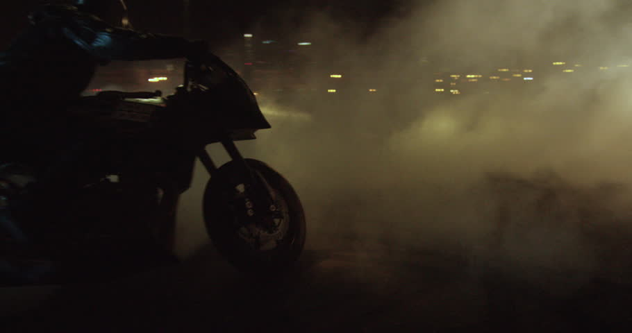 A man on a sport bike does serious burnouts / donuts in slow motion at night then drives off | Shutterstock HD Video #23480698