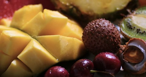 Dolly extreme close up view of an assortment of fresh, healthy, organic fruits