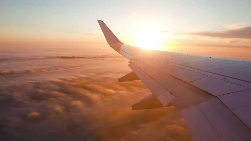 Aerial view of sunrise through airliner window #23524966