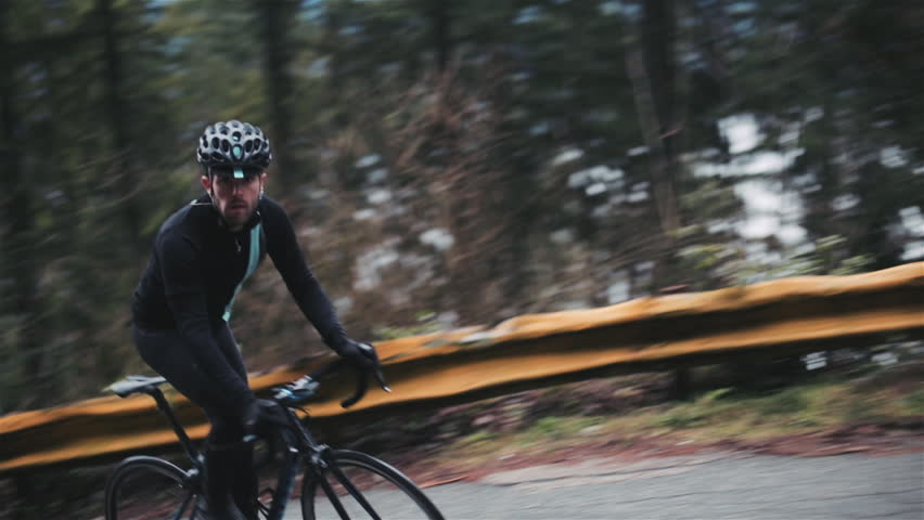 Man Cycling in Vancouver Rainforest Roads | Shutterstock HD Video #23530309