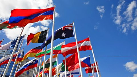 Flags of the different countries on a background of the blue sky