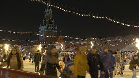 MOSCOW, RUSSIA , January 15, 2017: Skating rink on the Red Square. People fun ride in the evening.