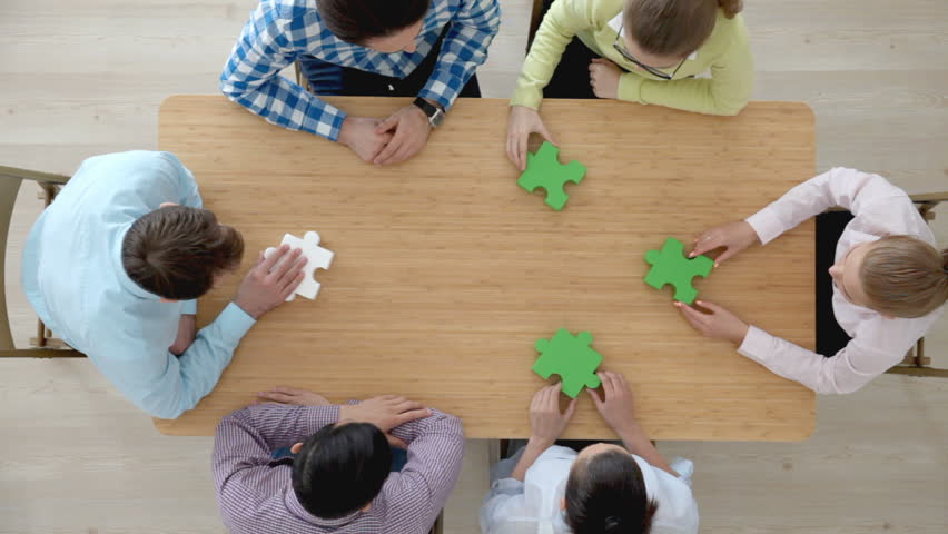 Hipster business successful teamwork concept, business group assembling jigsaw puzzle | Shutterstock HD Video #23584711