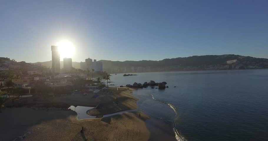 A selection of 4K drone shots of the touristic beach area of Acapulco, Mexico during sunrise