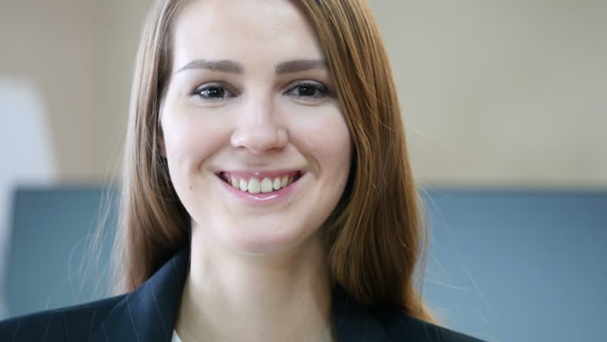 Close Up of Smiling Woman Face in Office | Shutterstock HD Video #23637076
