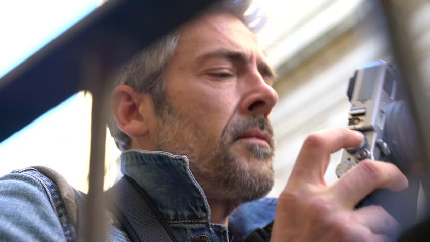 Man in city street taking pictures | Shutterstock HD Video #23640916