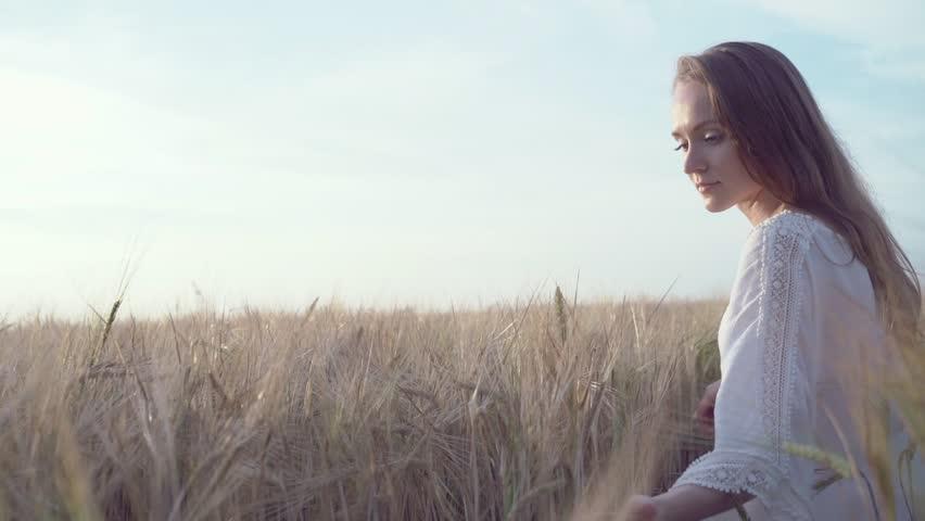 Beautiful woman in a field    Shutterstock HD Video #23645527