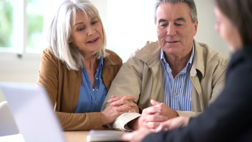 Senior couple meeting financial adviser for investment                 #23654893