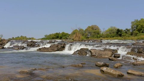 Famous Popa water falls on river in Caprivi strip region, North Namibia, Africa wilderness landscape