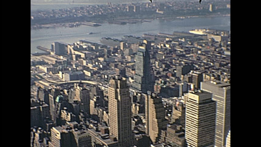 New York, United States of America - circa 1970: Vintage aerial view panorama from top of Empire State Building, with Top of The Rock, Rockefeller Center, Central Park and city traffic.