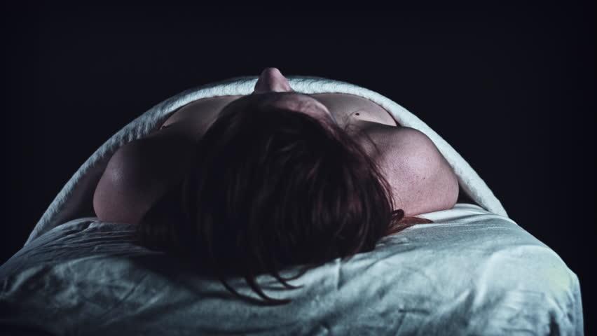 4K Crime Morgue. Mortician Covers Dead Body