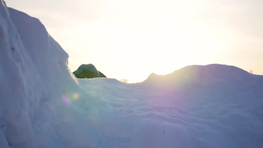 Kid playing in snowy mountains, to climb to the top. At sunset | Shutterstock HD Video #23687389