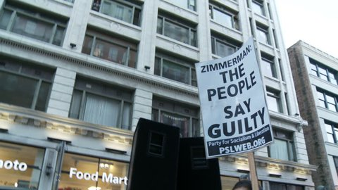 """""""THE PEOPLE SAY GUILTY"""" Sign. Activist protests against George Zimmerman in downtown Los Angeles, California on July 16th, 2013."""