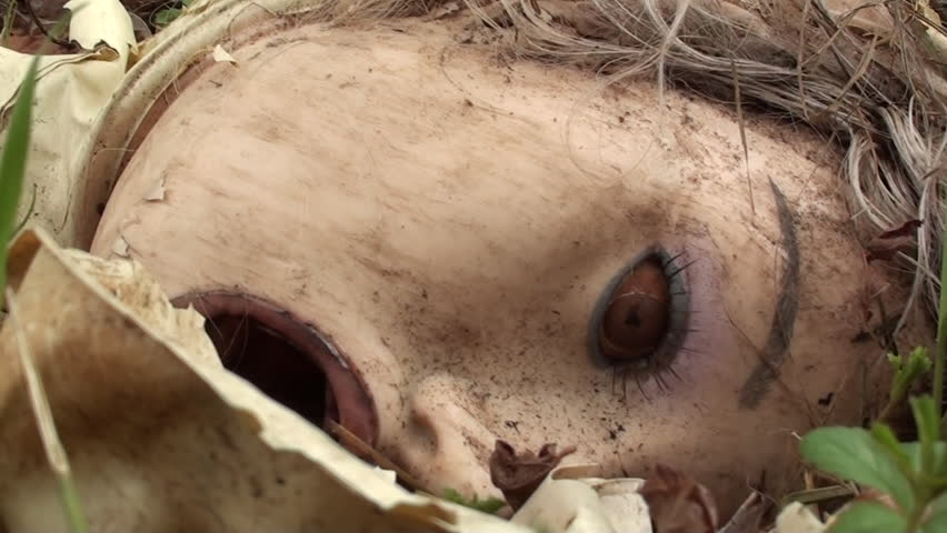 Sex doll's head cut away and thrown into ditch. Dirty stuff. Spooky and scary sight from this close up shots. ideal using for documentaries, music videos, montages, etc.