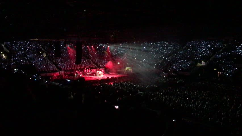 Thousands of children are singing your favorite song in night stadium with crazy lights,February 2017,4K