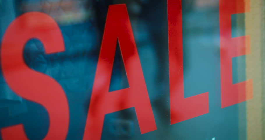 Big sale sign, people pass by in the background, in slow motion   Shutterstock HD Video #23738590