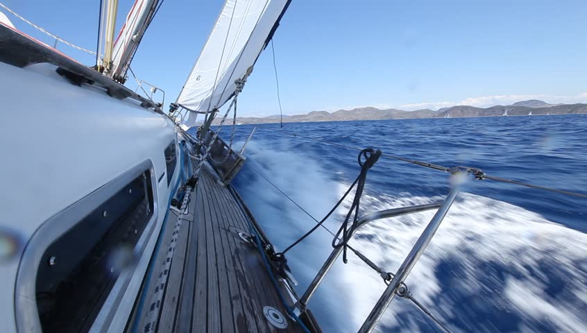 Sailing in the wind through the waves. Sailing boat shot in full HD at the