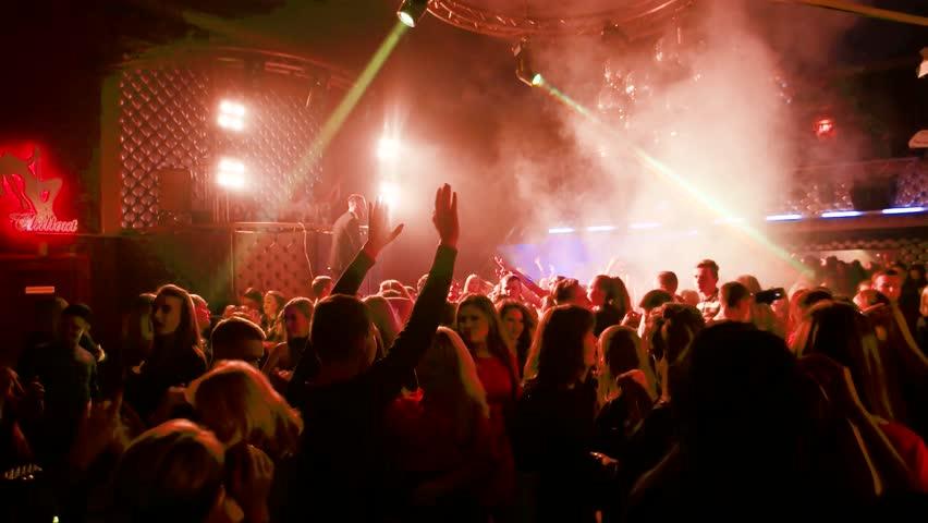 Kherson, Ukraine-17 november 2016: Student Day in Rest Club Student party in nightclub under flash lights dancing people in Kherson, Ukraine-17 november 2016.   Shutterstock HD Video #23751274
