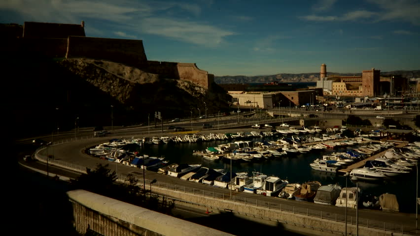 Marseilles, France - CIRCA October 2009: Large view of the city's port with cars circulating. | Shutterstock HD Video #23766019