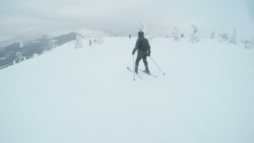 Riding on skis man down road | Shutterstock HD Video #23766292
