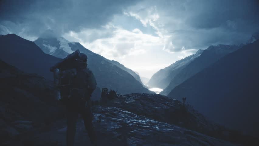 Silhouette of a backpacker walking on the peak of a mountain, Santa cruz Trek, Peru. Slow motion.
